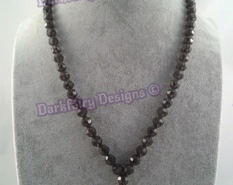 Beaded necklace with small cross charm