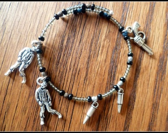 all they want to do is eat your brains!  (zombies on memory wire charm bracelet)