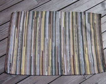 Green and yellow with brown accent handwoven rag rug made from recycled t-shirts