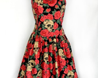 Halloween skulls in roses dress.