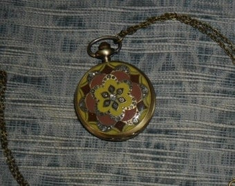 Pocket flower of life watch raspberry
