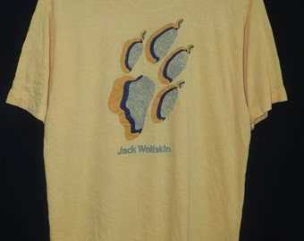 90s//Jack Wolfskin//Born To Be Wild//Outdoor Equipment//Paperthin Soft Yellow Colour//Tshirt//Made In Japan