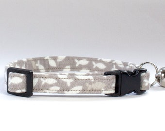 Fabric cat collar made using a fish print - bell and breakaway buckle.