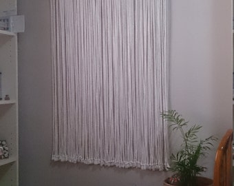 Macrame curtain. Macrame curtain with wooden beads for doors or windows. Cotton curtain