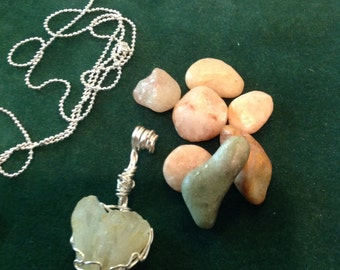 Heart shape natural Quartz pendant with free form wire wrapping .