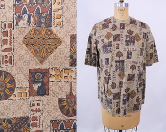 1950s novelty blouse | brown Egyptian novelty print button back top | vintage 50s blouse | W 41""