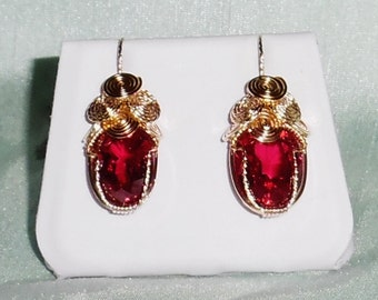 33 cts Genuine Oval Red Sapphire gemstones, 14kt yellow gold Pierced Earrings