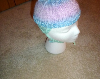 Handknit cap with ear flaps and tie