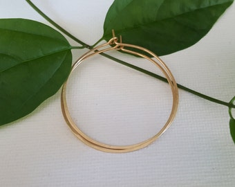 14kt yellow gold filled hoops, diameter opproximately 1 3/8""