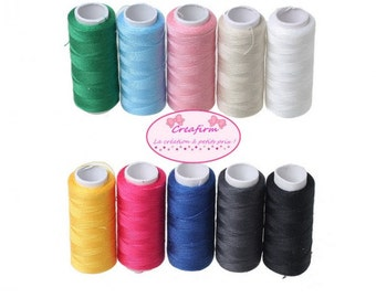 10 multicolored spools of sewing thread