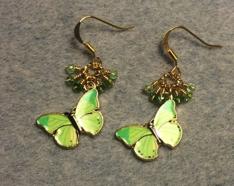 Apple green enamel butterfly charm earrings adorned with tiny dangling green Chinese crystal beads.