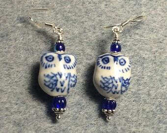 Dark blue ceramic owl bead earrings adorned with dark blue Czech glass beads.