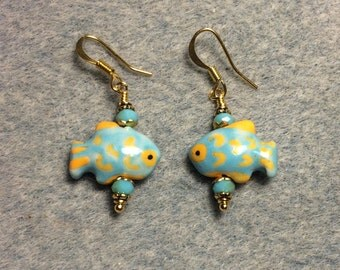 Turquoise and yellow ceramic fish bead earrings adorned with turquoise Chinese crystal beads.