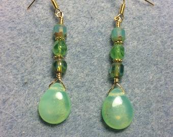 Opal green Czech glass pear drop earrings adorned with opal green Czech glass beads.