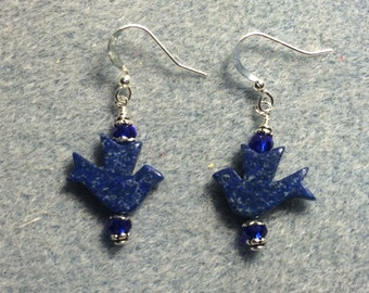 Lapis lazuli flying dove bead earrings adorned with blue Chinese crystal beads.