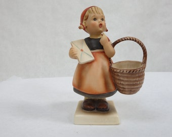 1950's era Hummel figure, girl with basket and letter. 6.25 inches tall