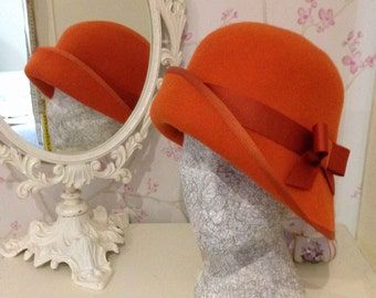 ASYMMETRIC CLOCHE HAT