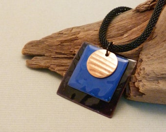 Layered pendant of torch fired enamel and copper