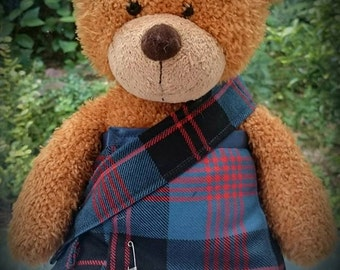 Sam Heughan's Angus Ancient kilt for a teddy? Order a bespoke kilt + sash for a teddy or doll in your clan tartan. Hand made in the UK