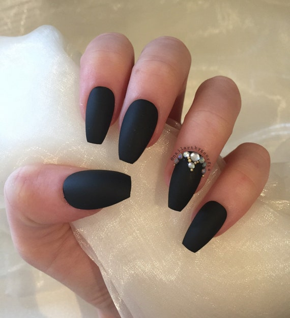 Matte black coffin nails with rhinestones and gold beads