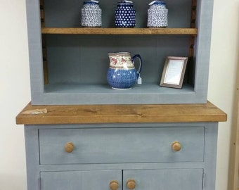 Solid wood hand painted dresser in grey with waxed shelves.