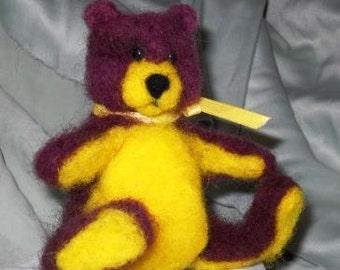 Purple and yellow bear