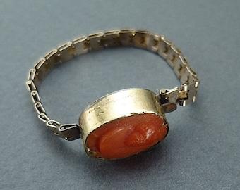 Coral cameo - child's bracelet?