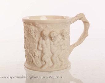 Parian Ware Tankard, White embossed mug, satyr, cherub, grapes and donkey, antique mug, 1800's . Please read description.