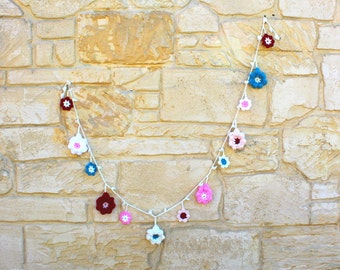 Garland: hand crocheted flower garland in teal, garnet, pink and cream yarn