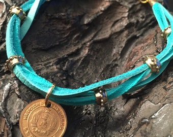 Coin Jewelry- Brass Bulgarian coin, gold bead, and robin's egg blue deer skin braided leather bracelet-one of a kind