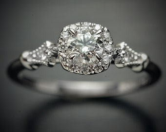 Platinum or Gold Diamond Engagement ring with a round center and cushion halo