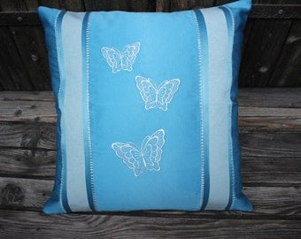 Celeste pillow with embroidered butterflies made in Italy