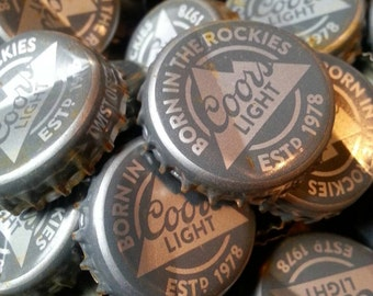 100 dented COORS LIGHT beer bottle caps