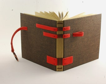 Travel diary for man, 14cmX14cm, Coptic binding, coral leather hinges, closing carabiner, guestbook, diary