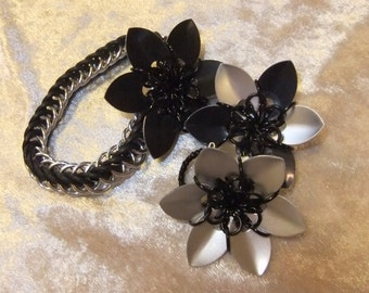 Black and silver scale handflower
