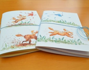 2 x A6 saddle stitched notebooks with illustrated dog covers