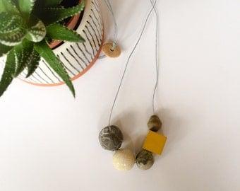 Handmade ceramic and stoneware beaded necklace