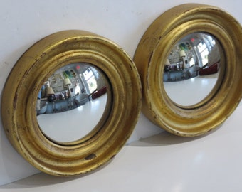 Pair Of Hollywood Regency Convex Mirrors With Gold Gilt Metall Frames.