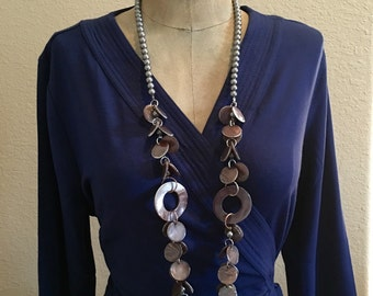 Great beaded necklace to add texture to your outfit!