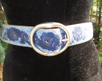 """Lucky Brand bue leather with darker blue floral embroidery silver buckle belt. Made in India. Fits 31-35"""""""