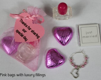 Pink wedding favour bags with a selection of fillings - heart, butterfly, flower or lovebird theme