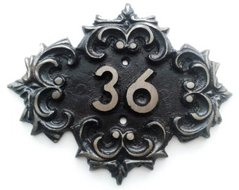 Metal ornament door number 36, old-fashioned apartment room thirty-six