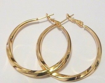 Huge 14 kt yellow gold filled  hoop earrings