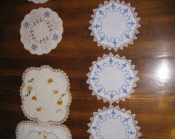 Vintage hand embroidered doilies