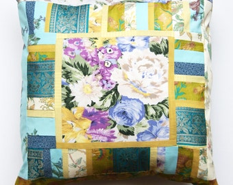 Floral cushion in yellow, turquoise and lilac cotton and silk