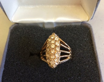 Zircon and gold tone ring