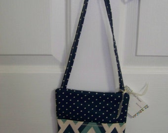 Sling bag in teal and navy chevron