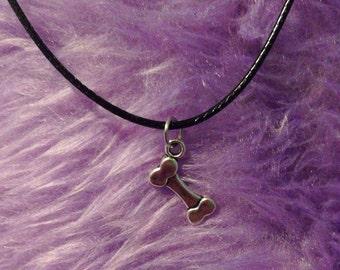 Dog bone or alice in wonderland rabbit silver pendant necklace