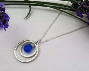 Silver circle pendant with royal blue chalcedony gemstone
