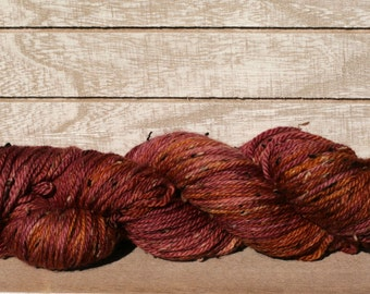 Hand dyed aran weight tweed yarn for hats and mittens, cranberry hand dyed yarn, tweed yarn that has been hand dyed in the sun